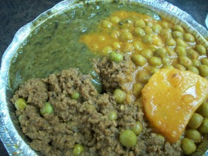 Lamb keema, aloo mattar and mustard greens.
