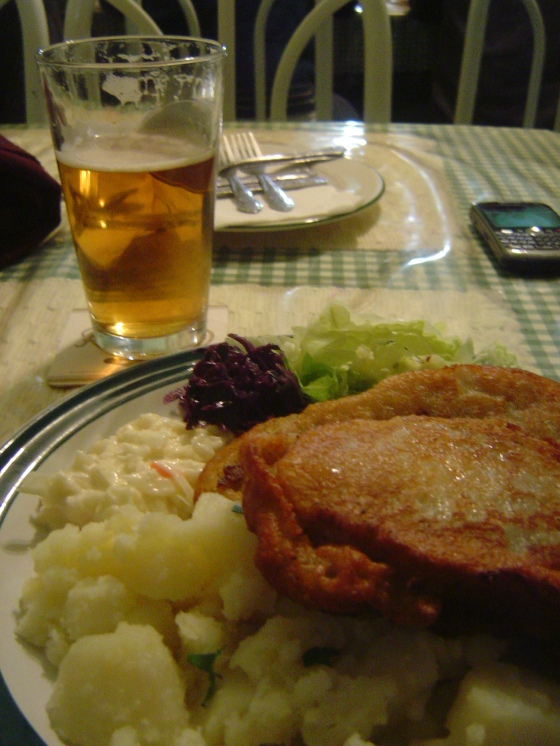 Belehradsky Bravcovy Rezen pork breaded in potato batter w. potatoes, cole slaw and beet cabbage salad