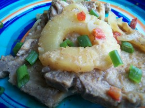 Sweet and Sour Pork Chops Garnished with Pineapple and Green Onions